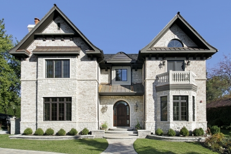 Front view of luxury stone home with balcony photo