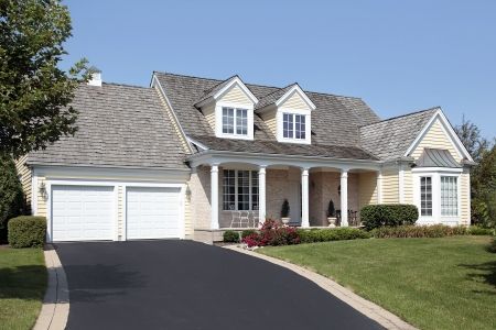 driveways: Home in suburbs with columns and double garage