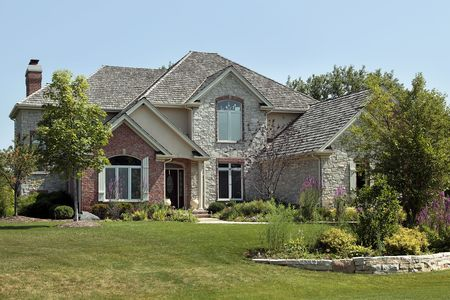 Luxury brick home in suburbs with stone terrace Stock Photo - 6761225