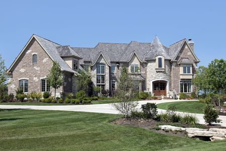 Luxury brick and stone home with turret photo