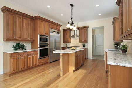 Kitchen in new construction home with wood cabinetry photo