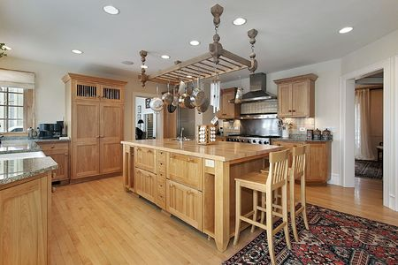 Kitchen in luxury home with butcher block island photo