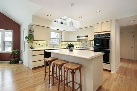 island: Kitchen with white island in luxury home Stock Photo