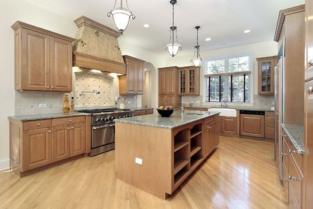 cabinetry: Kitchen in new construction home with oak cabinetry Stock Photo