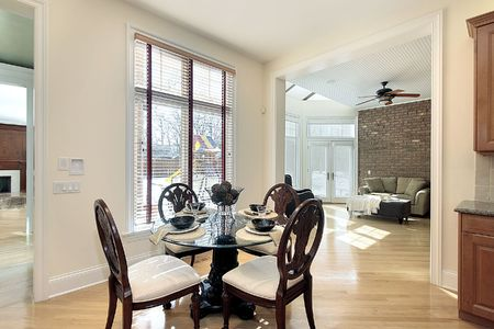 Eating area in luxury home with views in sun room photo