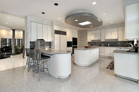granite floor: White kitchen with two islands in luxury home