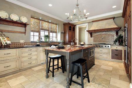 Kitchen in luxury home with granite island Archivio Fotografico