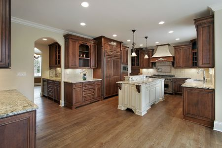 island: Kitchen in new construction home with oak cabinetry Stock Photo