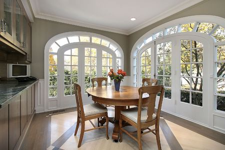 dining table and chairs: Eating area in luxury home with circular windows