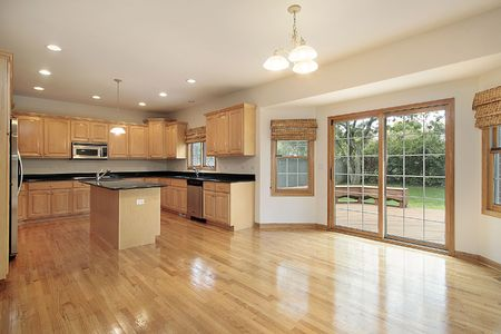 eating area: Kitchen and eating area in vacant home Stock Photo