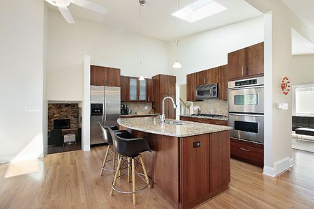 Modern kitchen with tall ceilings and granite island