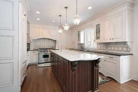 Kitchen in luxury home with marble and wood island photo
