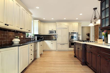 Kitchen in luxury home with wood island photo