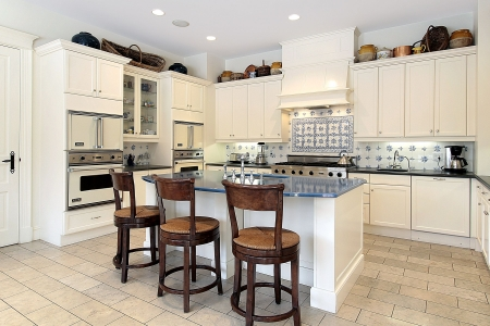 Kitchen in luxury home with marble island Stock Photo - 6732510