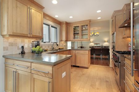 Kitchen in luxury home with oak wood paneling Stock Photo