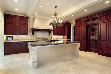 Kitchen in luxury home with cherry wood paneling