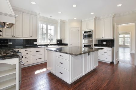 island: Kitchen in luxury home with marble island