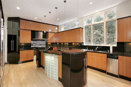 Kitchen in luxury home with wood paneling and marble island