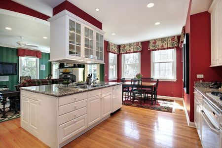 kitchen cabinets: Kitchen in suburban home with eating area