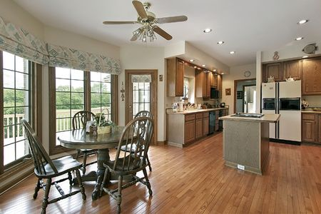 Kitchen in luxury home with eating are photo