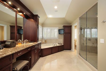 Master bath in luxury home with wood tub