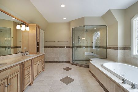 Master bath with glass shower and large tub photo