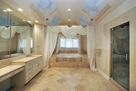 Master bath in luxury home with ceiling design photo