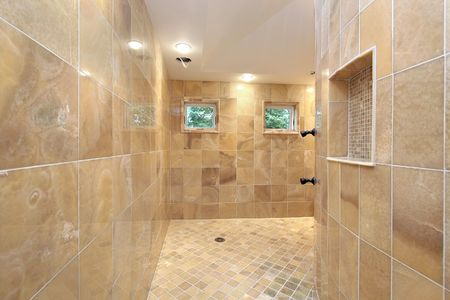 Large shower in luxury home with marble walls photo