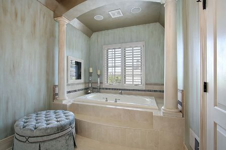 Master bath in luxury home with tub columns photo