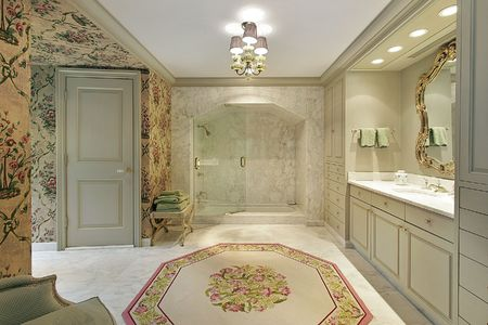 Master bath in luxury home with marble shower Imagens
