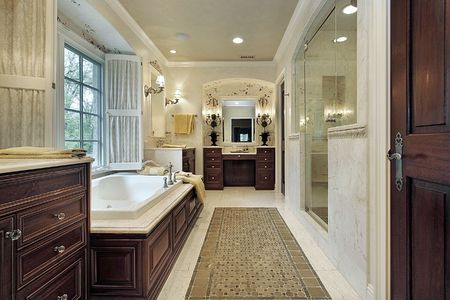 cabinetry: Master bath in luxury home with wood cabinetry Stock Photo
