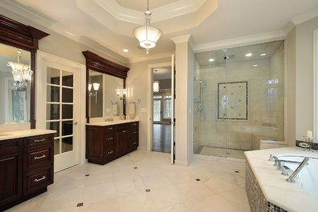fixtures: Master bath in new construction home with glass shower