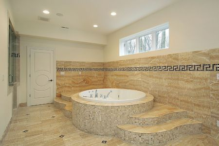 Bathroom in luxury home with round tub photo
