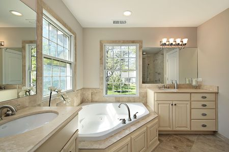 Master bath with tub in new construction home photo