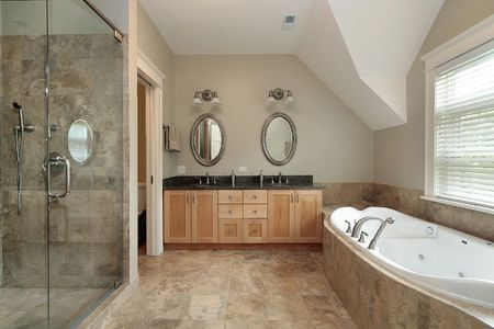 upscale: Master bath in luxury home with large glass shower