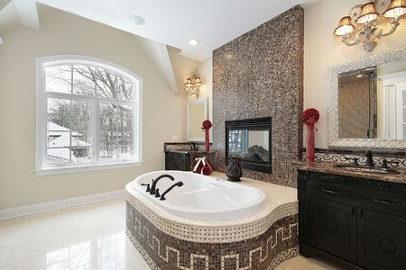 Master bath in new construction home with marble tile tub Stock Photo - 6733434