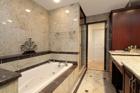 Master bath in luxury home with marble tub  photo