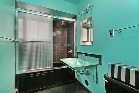 Master bath in contemporary home with green walls photo