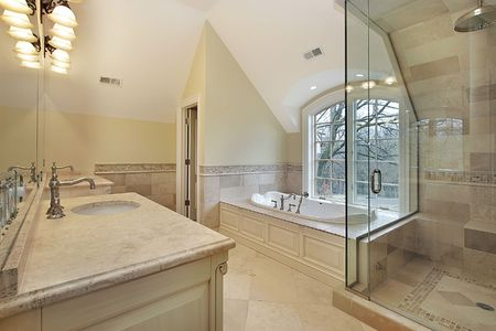 Master bath in new construction home with glass shower photo