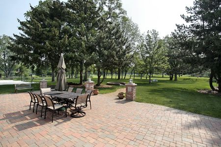 Brick patio of luxury home with golf course view photo