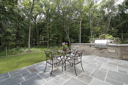 Bluestone patio and stone grill outside luxury home Stock Photo - 6738205