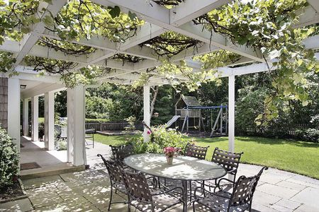 Patio in luxury home with white wood beams