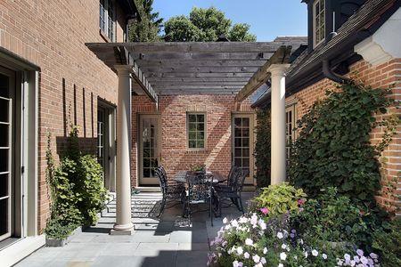 Bluestone patio with columns and wood pergola photo