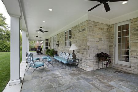 patio chair: Bluestone patio with columns and blue furniture
