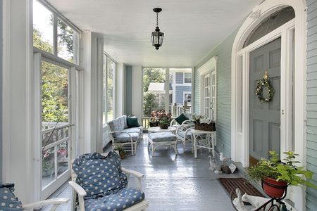 screened: Screened in porch with teal walls in luxury home Stock Photo