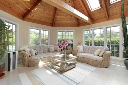 fixtures: Sunroom with wood beams in luxury suburban home