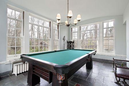 sunroom: Pool table in sunroom of luxury home