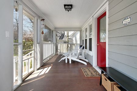Porch in suburban home with red door