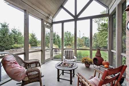Screen porch in luxury home with patio view Stock fotó