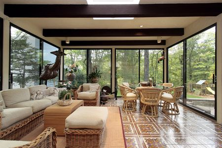 home lighting: Sunroom in luxury home with patterned tile